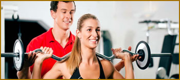 Woman with Personal Trainer - Muscle Strength